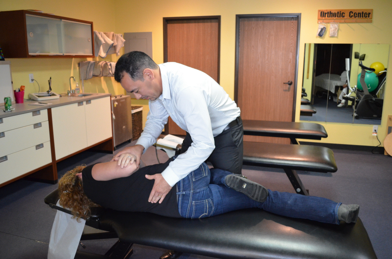 Chiropractic adjustment by Dr. Rodrigo Pina at Access Health Center